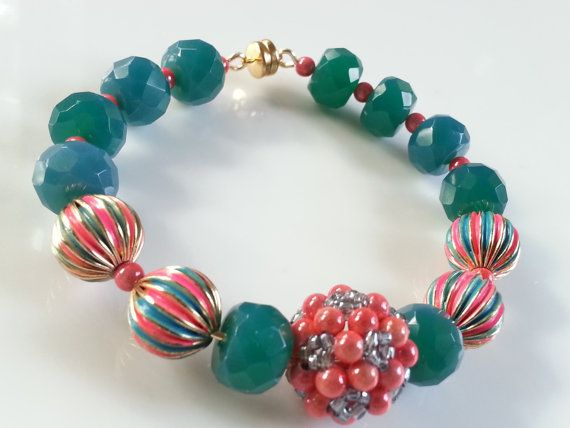 Wear this bracelet and you will have more fun. Perfect for a SMALL wrist, this playful little number is just full of color, texture, and delight! This artful piece contains faceted teal jade, Japanese Miracle beads, colorful gold plated brass beads and Czech glass beads that--all combined-- just ooze with playful spirit. Connected with a strong magnetic clasp, this fun piece is one that you will feel secure wearing for years to come. Want to present this as a Holiday ornament? Just select…
