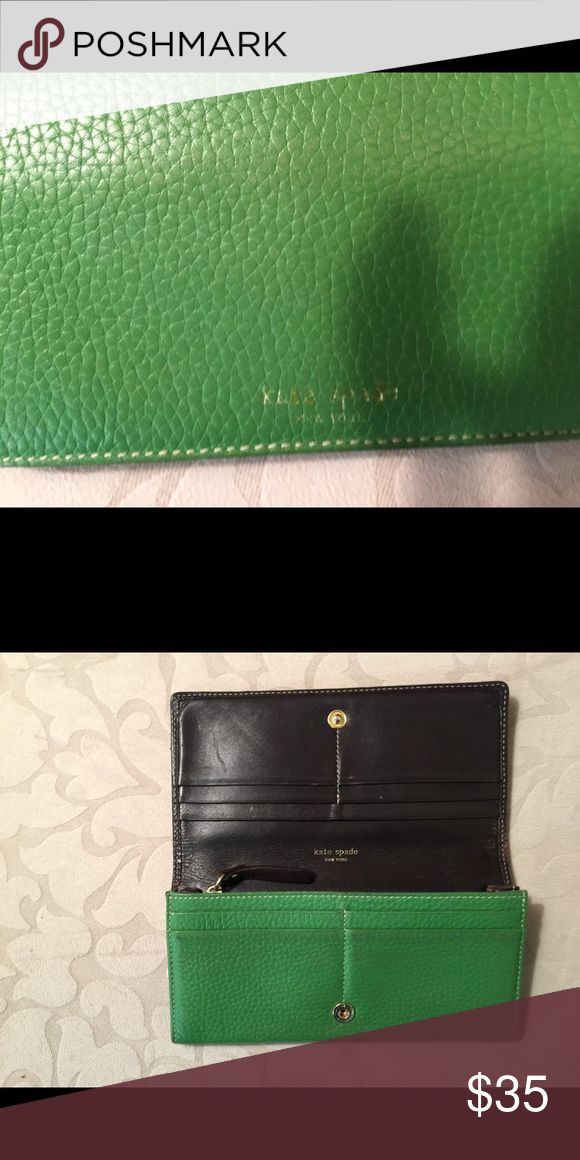 Green Kate Spade wallet **SALE*** Pre-loves Kate Spade wallet with credit card slots and change purse. As you can see, the Kate Spade on the front and gold has faded a little, but the wallet is an overall good condition. Price reflects faded name stamp! kate spade Accessories