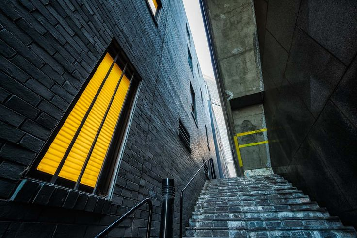 A steep staircase leads the visitor through a narrow alleyway in the City of Melbourne, Australia.