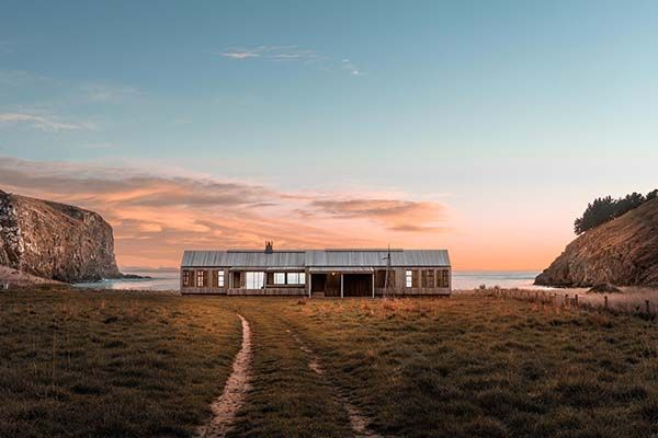 Contemporary farmhouse surrounded by rugged beauty in New Zealand