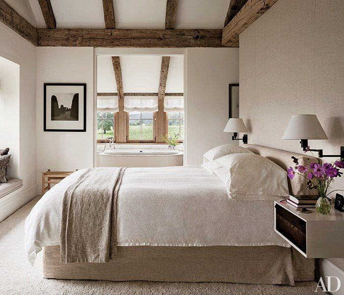 A Lynn Geesaman photograph is displayed in the master bedroom; the nightstand is by BDDW, and the rug is by Edward Fields