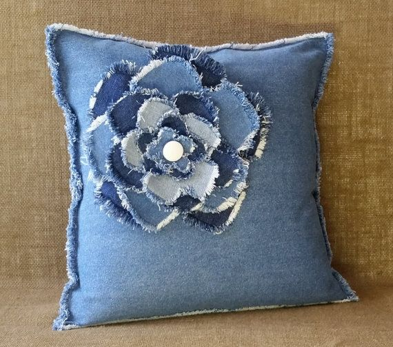 I LOVE FLOWERS especially BIG layered fluffy fringed ones. I love to use denim material. I used new denim for the pillow and recycled denim for the flower to make this pillow. All of my designs are unique and 100% handmade by Miss Thread. Thank you for taking a look at my stuff and supporting my love of recycling! - Michele