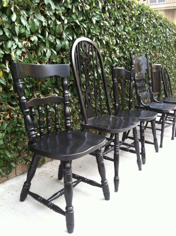 Black Vintage Dining Chairs All Painted Black Around A Large Farmhouse Table.  I Would Add Matching Grey Cushions.