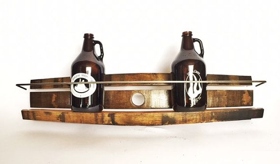 This Growler Rack holds 6 full size,64oz growlers.  Looking great in any decor, this combination of welded steel and 1 oak is a great answer for