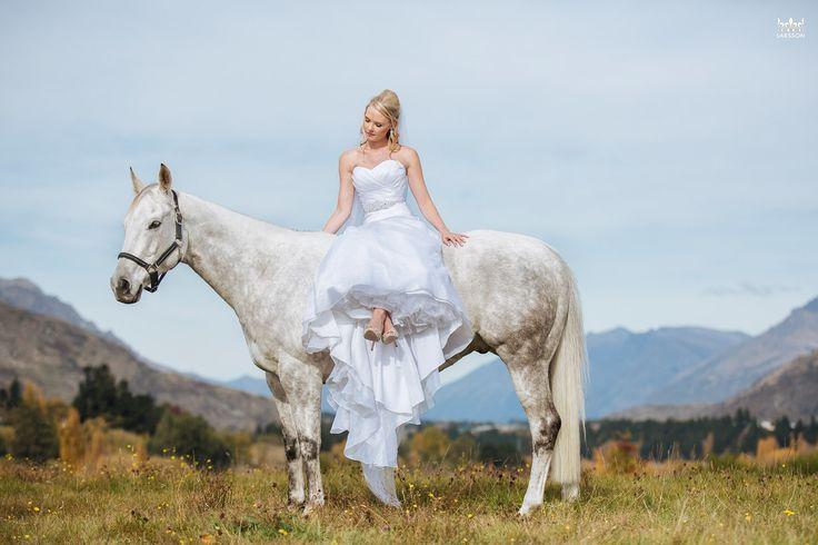 Wedding shots on horse in Queenstown