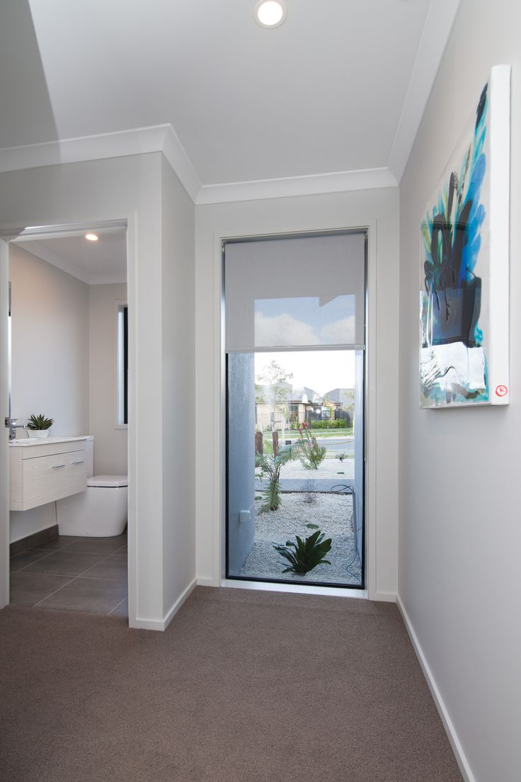 A window to the floor, adds natural light into the hallway space. Just don't confuse it with a door!