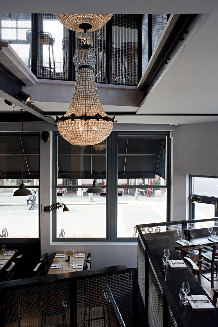Goat, Chelsea, London - by Finch Interiors. restaurant. simple glam. exposed pealing wall paint. chandelier