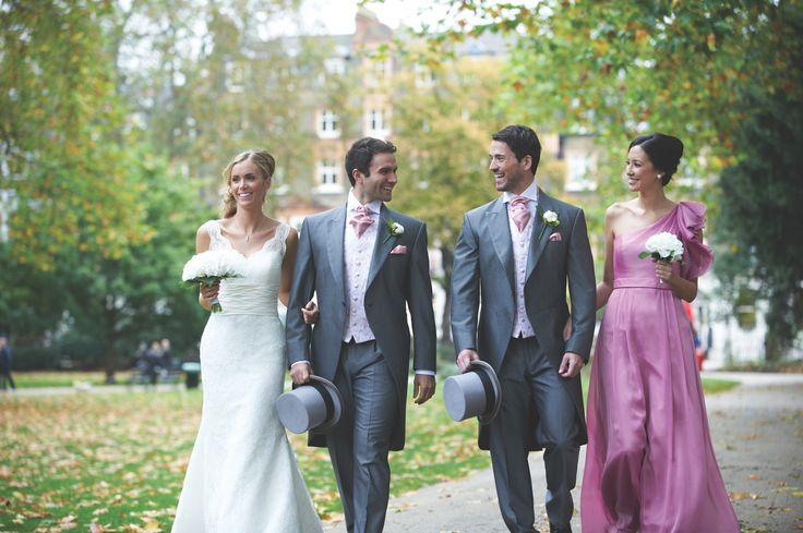 Smart, tailcoat, silver grey menswear suits with soft pink cravat, hanky and patterned waistcoat!