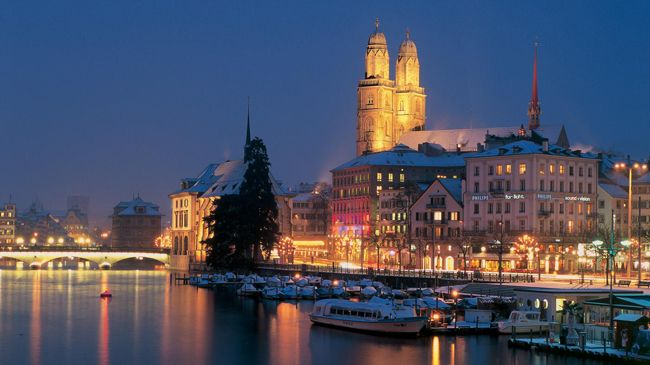 """Zurich. As a """"metropolis of experiences"""" by the water, with a magnificent view of the snowcapped Alps on the horizon, Zürich offers a unique mixture of attractions. Switzerland"""