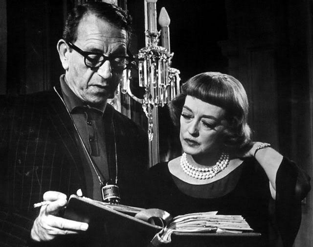 Director Paul Henreid and Bette Davis go over the script for Dead Ringer