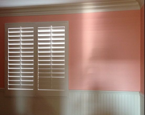 Peach Paint And White Wainscoting For Nursery Walls