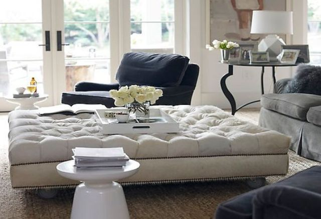 Oversized Tufted Ottoman Serves As A Coffee Table In This Living Room Ottoman In Living Room Oversized Ottoman Tufted Ottoman