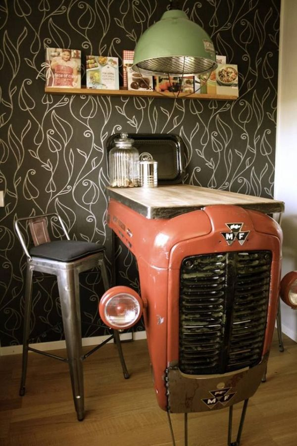 It's unfortunate that I can't find the craftsman responsible because I'd like to congratulate him/her on such an outstanding job. The hood of an old Massey Ferguson tractor is now a kitchen table that combines both cosmopolitan and rustic ambiances.-via Recyclart...