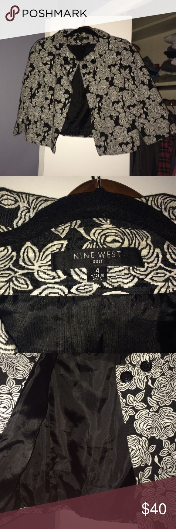 Nine West black & white jacket 3/4 sleeve. NWOT Lined, worn once, and in perfect condition. Very classy over a dress or with a wife beater, trashed jeans, and heels. I got a ton of compliments on this number. Nine West Jackets & Coats Blazers