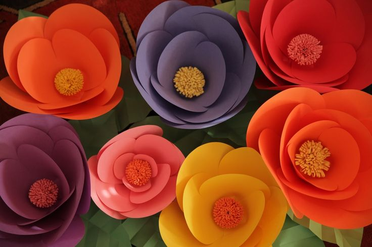 Simple, colorful large scale flowers made with inexpensive construction paper! Robert Mahar's Giant Paper Flowers - DIY video tutorial.