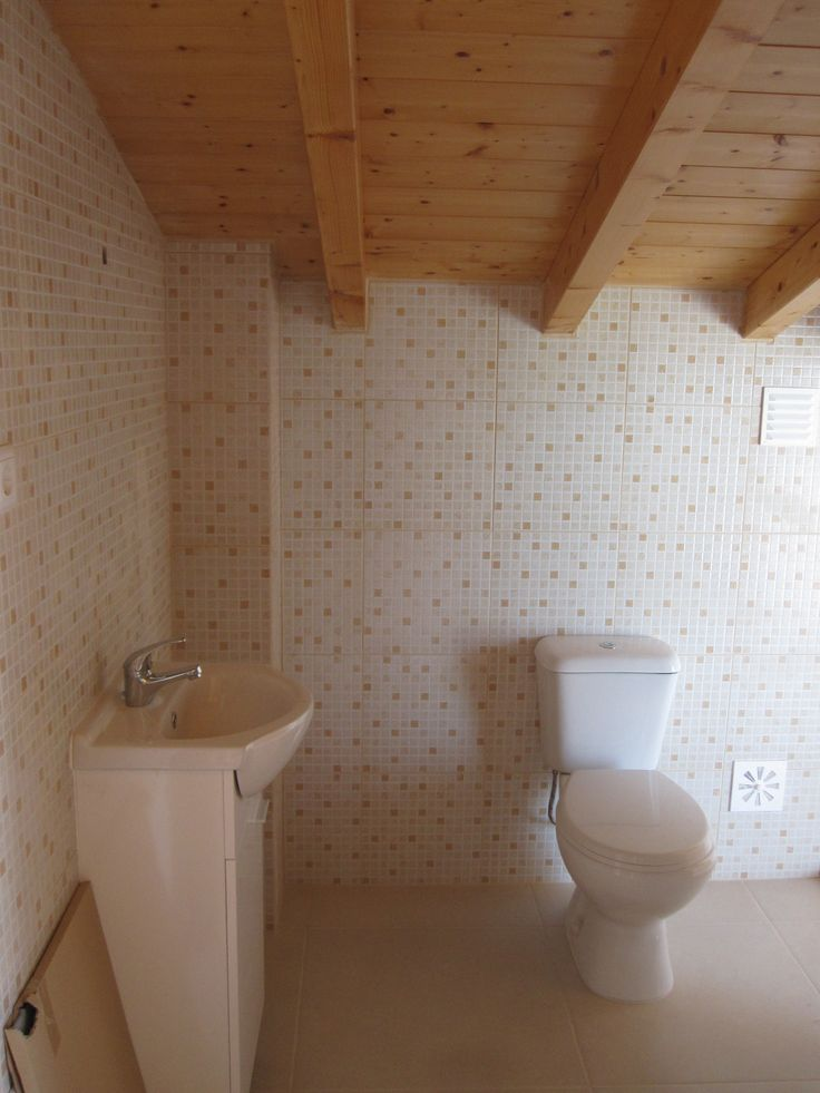 Bathroom equipped with shower hand basin and toilet
