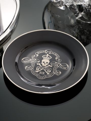 Okay, so this is a dessert plate, but I think it's a great inspiration for a very awesome tattoo.  Keep the skull & crossbones and sash/ribbon but customize the verbiage.