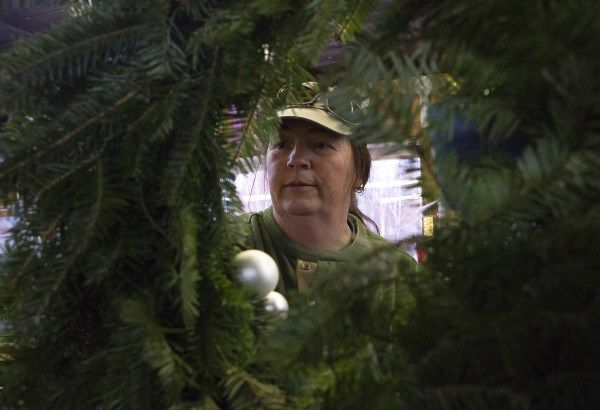 Piper Mountain Christmas Trees'  Maria Kingsbury begins to decorate a wreath Dec. 11, 2014, in Newburgh.   Tipping in Maine is big business.  A different type of agriculture :) harvest