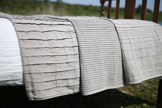 Pleated 100% natural linen linen blanket for a cozy wrap or for covering a bed. Comes in really large sizes and 3 styles. Gorgeous and not as $$ as I feared. App $170 for queen size (78x86) including shipping. (King 98x98 $240.) Name of etsy store is Magic Linen. From Lithuania.