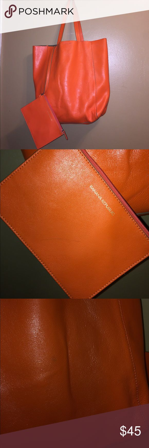 """Banana Republic Ashbury Orange leather tote bag Banana Republic Ashbury tote. Beautiful bright orange tote bag. Perfect color for the summer. 100% Leather. Light mark on the exterior; few pen markings inside and two light pen marks on the inner zip pouch. See photos. Measures 17.5"""" x 15"""" with 9.5"""" strap drop. Otherwise in great condition. Banana Republic Bags Totes"""