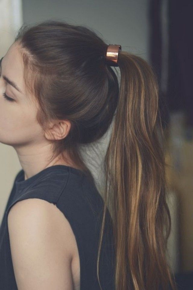 Another way to update your basic pony? Add a metallic cuff over your hair tie and tease for volume!