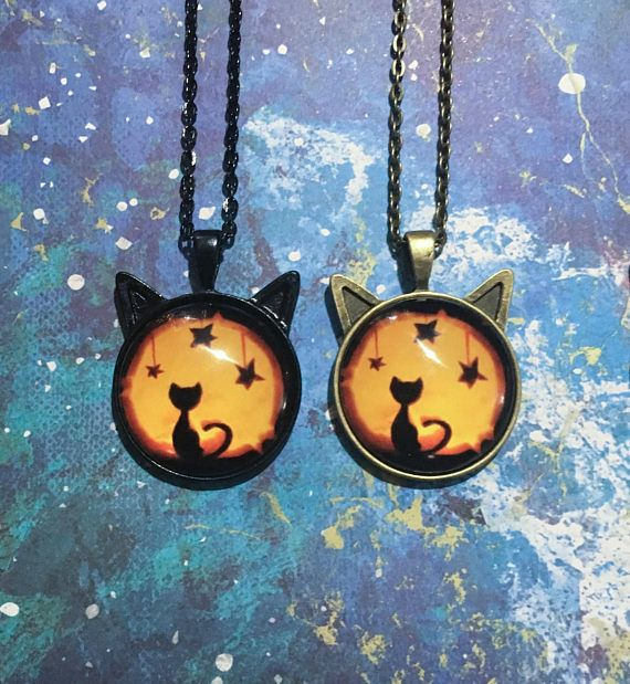 These kawaii cat necklaces were made with photo glass cabochans on a 25mm setting with cat ears, available in black or bronze. Please choose design option carefully in the drop down menu. First choose the pendant/chain colour from either black or bronze, then choose the colour of the designs