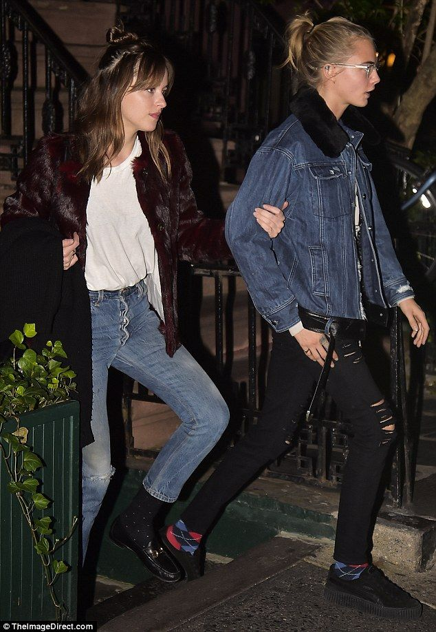 Who needsSt Vincent: Cara was walking arm-in-arm with the 50 Shades Of Grey starlet Dakota Johnson