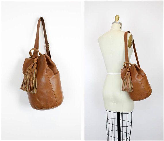 maple brown leather sling bag / big fringe tassels