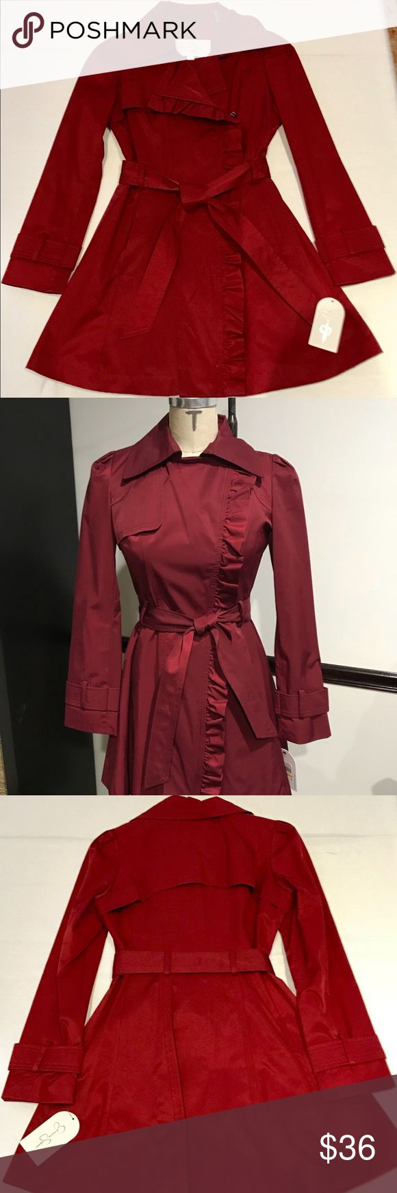 Jessica Simpson Belted Ruffle Trench Coat Jessica Simpson puff sleeve, belted, ruffle trimmed, 3/4 length, double breasted, zip trench coat. Cotton polyester blend shell with poly lining. Dry clean only. New with tags. Jessica Simpson Jackets & Coats Trench Coats