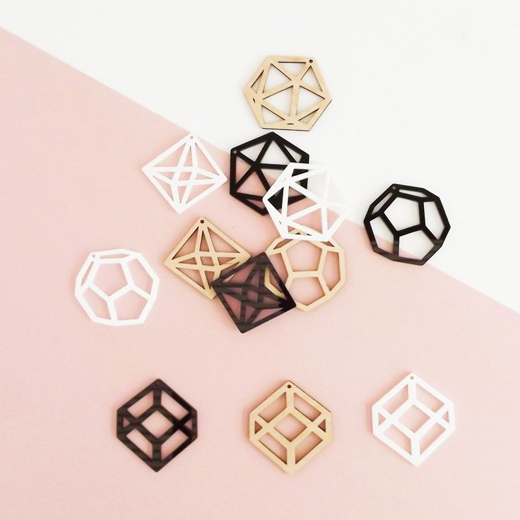 Great little set of geometric wooden holiday ornaments.