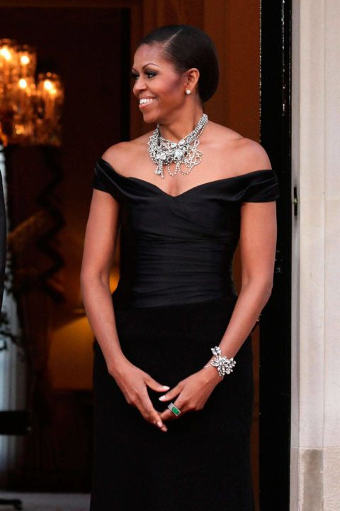 The First Lady completes her off-the-shoulder Ralph Lauren gown with a Tom Binns necklace at the U.S. Ambassador's residence in London.