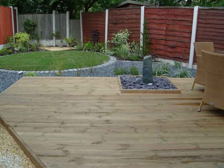 raised decking, lawn and planting