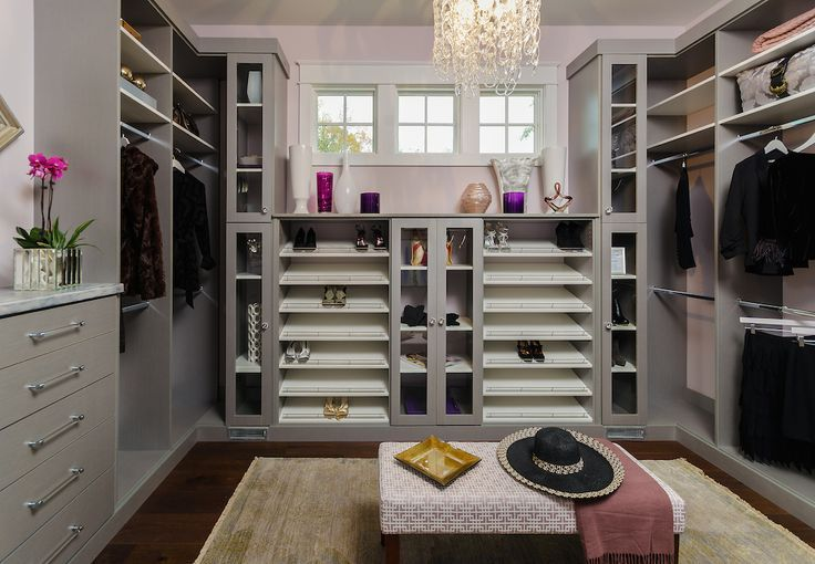 Contemporary closet features ceiling painted gray over pink painted walls lined with a gray modular closet system.