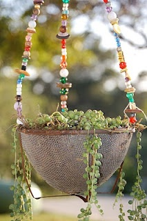 Hanging junk basket - a cute way to use beads.  The beads would be a great accent in a southwestern style garden with mosaics and succulents, but would also be great in a traditional garden to complement and add color to plants.