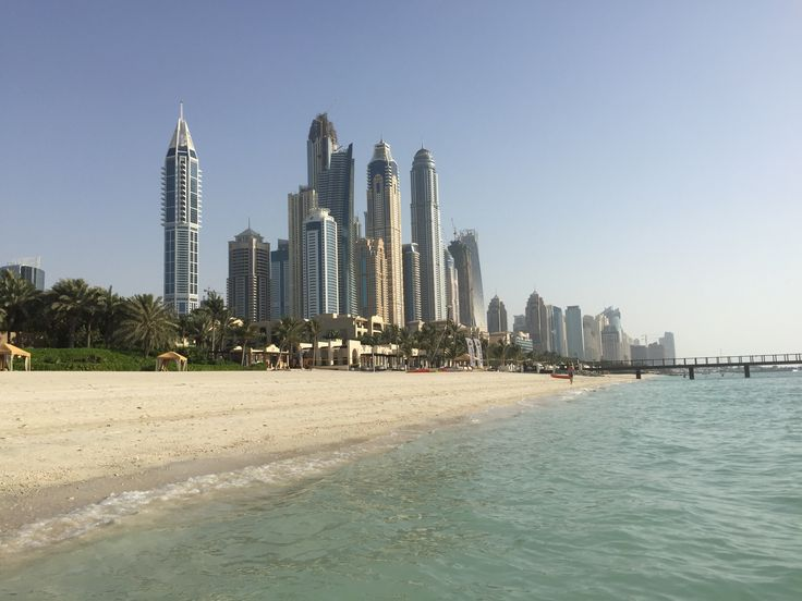 View from the beach of the One & Only Royal Mirage, Dubai looking at the skyscrapers surrounding the Marina area in Dubai