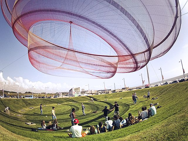 She Changes - Floating sculpture of string and mesh fabric in Porto, Portugal. By Janet Echelman