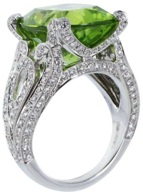 Garrard of London Peridot & Diamond Cocktail Ring. Estate Garrard London 18 karat white gold cocktail ring from the Regal Collection consisting of 1 cushion cut peridot weighing approximately 12.59 carats and accented by pave set round brilliant cut diamonds. Via @1stdibs.