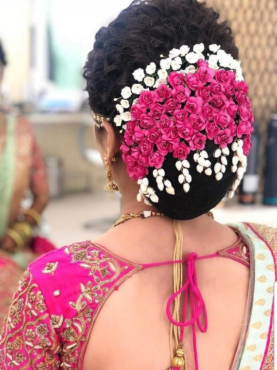 Beautiful Flower hair Bun with pink and white flowers.