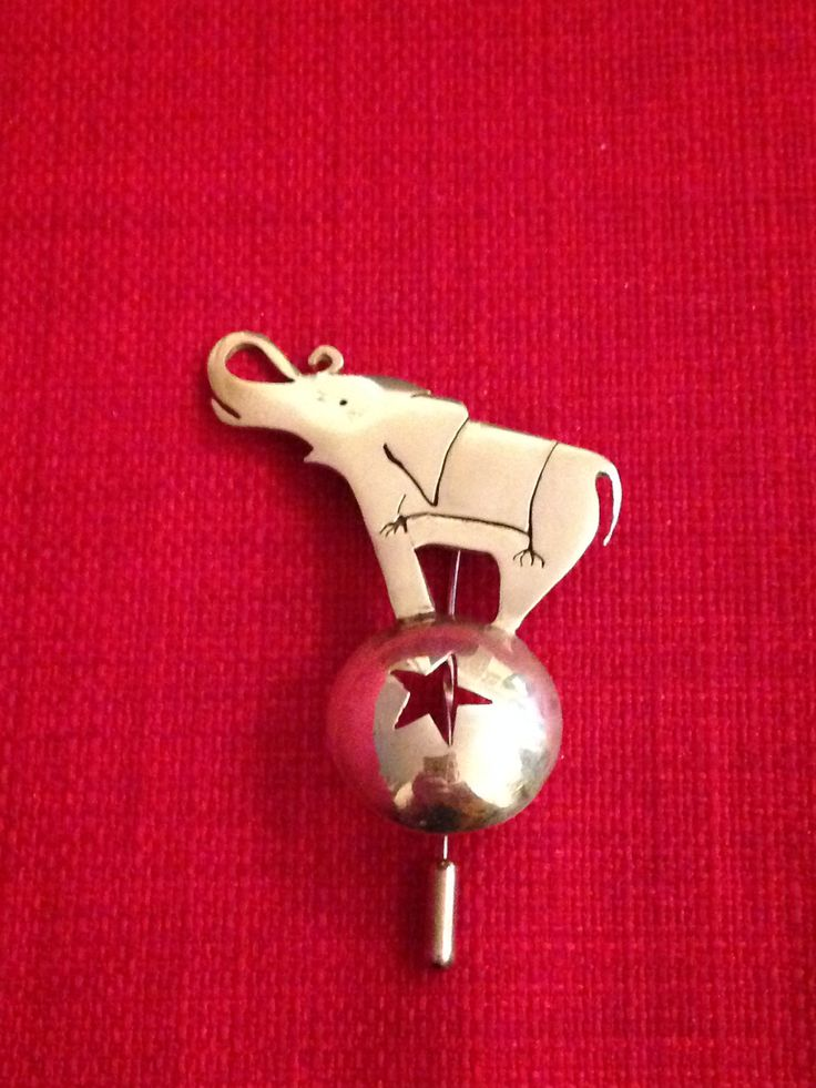 Elephant brooch hand made by Helen Green from silver sheet.
