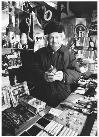 This Russian American vendor sells handicrafts from his booth  in Brooklyn,  New York.