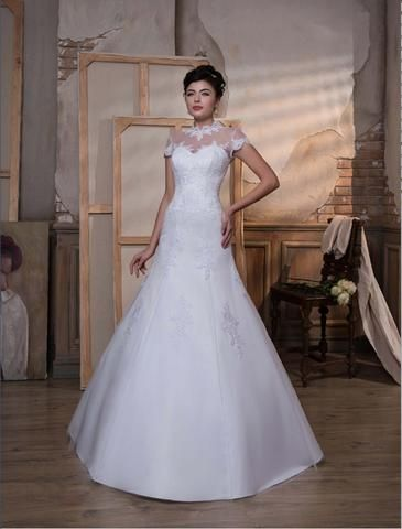 Jolien- is a stunning fit and flare wedding dress with lace bodice high neckline and cap sleeves flowing into a sating skirt with scattered lace detail.