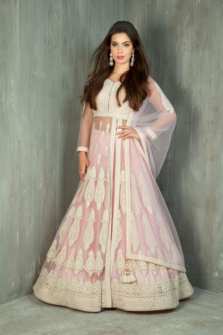 Net jacket, ghagra and dupatta embellished with thread and sequins work