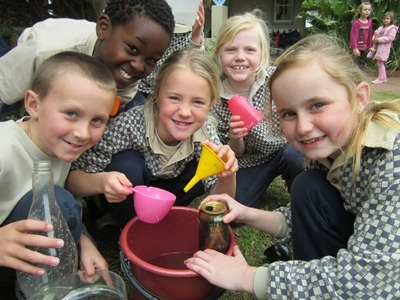Grade 2s at the Blouberg Preparatory Campus experimented with various containers.  They estimated the amount of water first and then measured the actual amount.  They discussed how accurate they were.