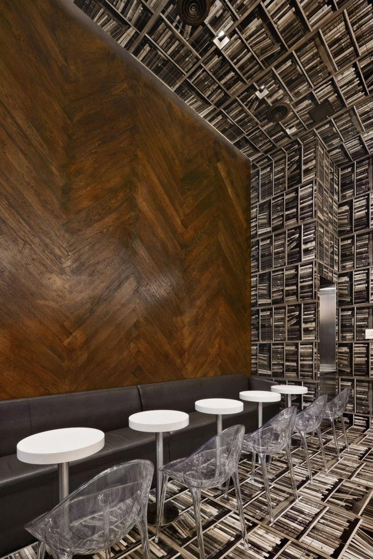 Library shelving gone awry. / D'espresso Cafe in New York City. Designed by Nema Workshop.