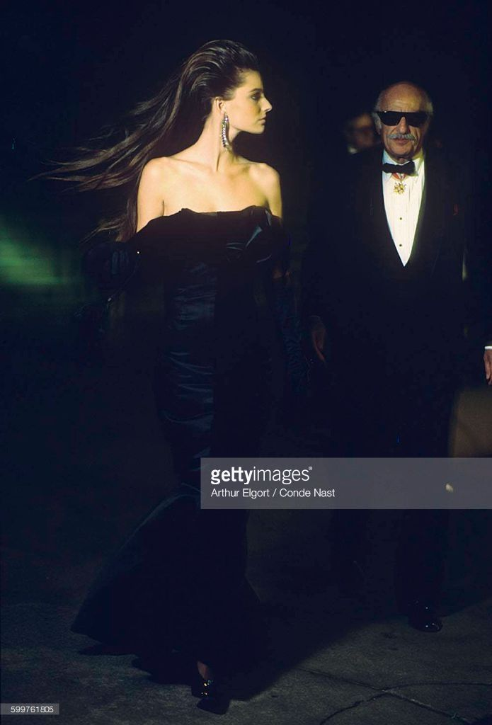 News Photo : Older male model in tuxedo and model Paulina...