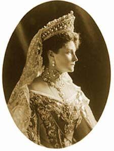 Empress Alexandra wears the famous Romanov Drop Pearl Tiara.