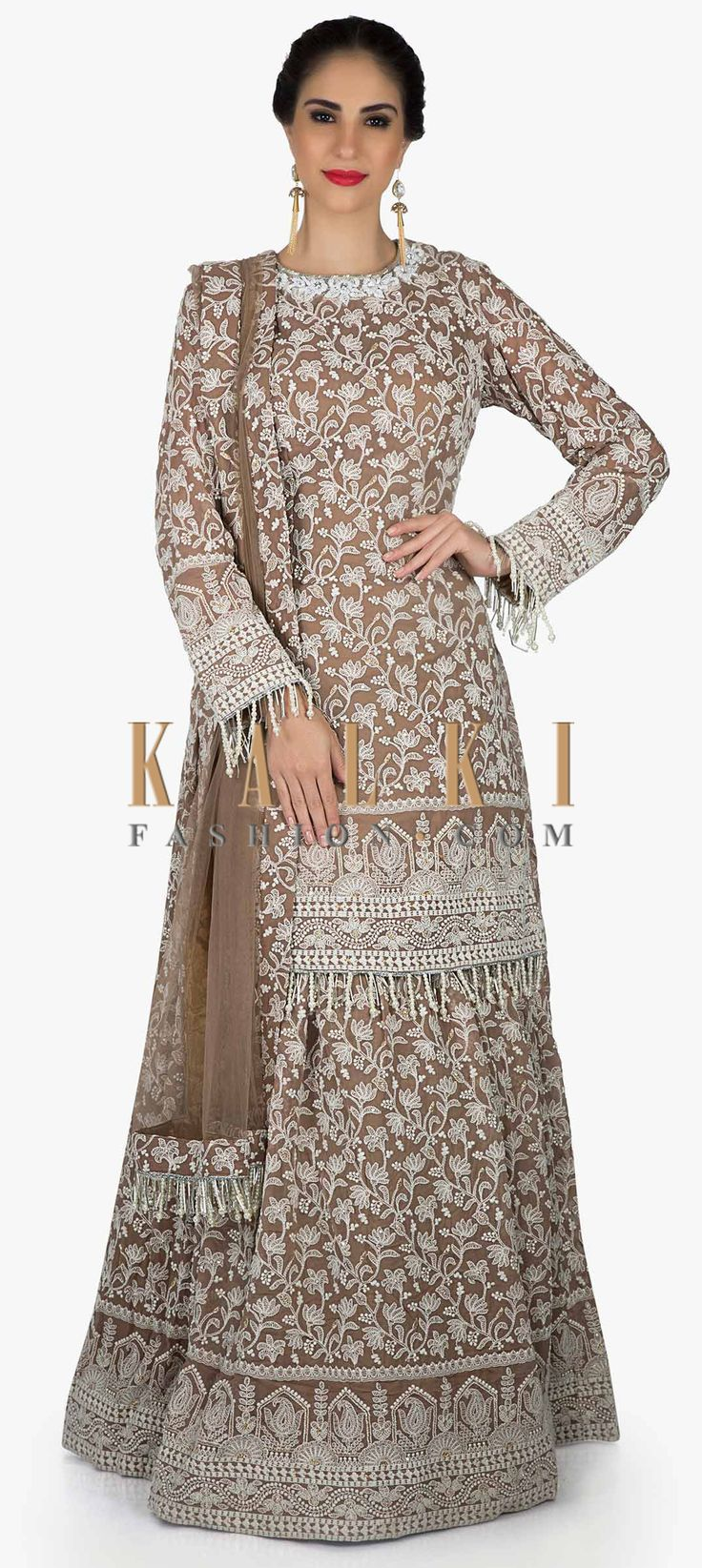 Brown lehenga with long blouse in white thread embroidery with fancy tassel only on Kalki