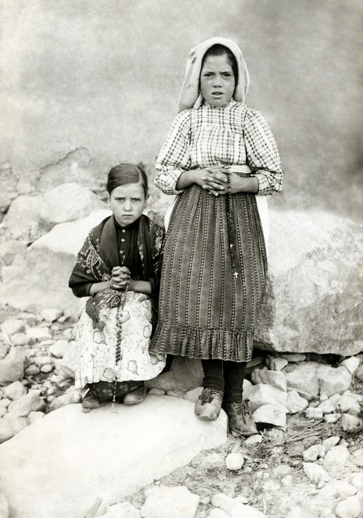 Jacinta Marto & Lucia Dos Santos.  The Holy Mother of God appeared to them in Fatima.  Fatima.org