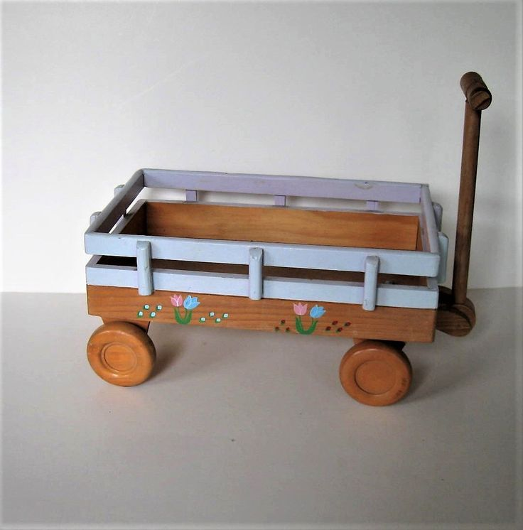 "Vintage Wooden pull toy Wagon,  13"" x 7 1/2"", Nursery decor, Shabby wagon planter, doll wagon, pink and blue tulips, wood wheels, gift idea by jewelryandthings2 on Etsy https://www.etsy.com/listing/480770166/vintage-wooden-pull-toy-wagon-13-x-7-12"