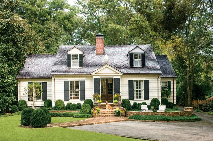 Charming Cottage Curb Appeal - Charming Home Exteriors - Southernliving. Architects Bates Corkern Studio turn a 1930s home into the neighborhood favorite by pairing timeless details with classic proportions. A new color palette, enlarged front entry, upgraded roof, and updated landscaping created a crisp Colonial home with a neighborly Southern accent.   See more of this Charming Cottage Curb Appeal Makeover